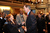 Governor John Hickenlooper speaks with state senator Linda Newell, left and state representative John Buckner after his speech.