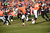 Denver Broncos wide receiver Trindon Holliday (11) returns a punt in the first quarter. The Denver Broncos vs Baltimore Ravens AFC Divisional playoff game at Sports Authority Field Saturday January 12, 2013. (Photo by Joe Amon,/The Denver Post)