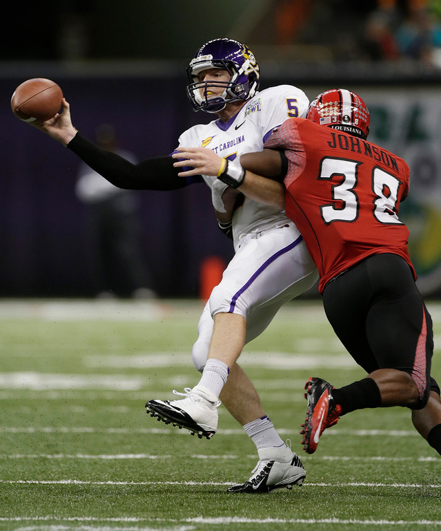 Description of . East Carolina quarterback Shane Carden (5) is sacked by Louisiana-Lafayette linebacker Trae Johnson (38) in second half of the New Orleans Bowl, an NCAA college football game in New Orleans, Saturday, Dec. 22, 2012. Louisiana-Lafayette beat East Carolina 43-34.(AP Photo/Dave Martin)