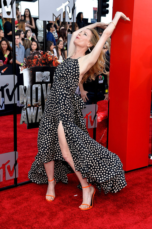 Description of . Actress Leslie Mann attends the 2014 MTV Movie Awards at Nokia Theatre L.A. Live on April 13, 2014 in Los Angeles, California.  (Photo by Michael Buckner/Getty Images)