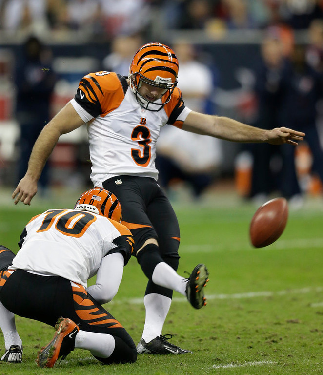 Description of . Cincinnati Bengals kicker Josh Brown (3) kicks a field goal against the Houston Texans as punter Kevin Huber holds during the fourth quarter of an NFL wild card playoff football game Saturday, Jan. 5, 2013, in Houston. (AP Photo/Eric Gay)