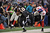 Running back Bernard Pierce #30 of the Baltimore Ravens is hit out of bounds by safety Antrel Rolle #26 of the New York Giants in the first quarter at M&T Bank Stadium on December 23, 2012 in Baltimore, Maryland. (Photo by Patrick Smith/Getty Images)