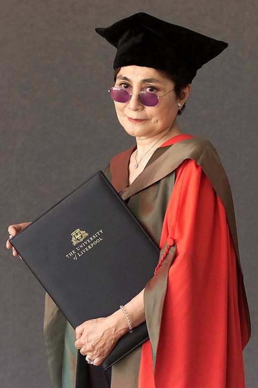 Description of . Yoko Ono poses after receiving the honorary title of Doctor of Law by the University of Liverpool, northern England, during a ceremony at the city's Philharmonic Hall Monday, July 2, 2001. The degree recognizes her artistic work and her patronage of the John Lennon Memorial Scholarship Fund, which she founded in 1991 and is now offered to students at the university.  (AP Photo/PA Phil Noble, POOL)