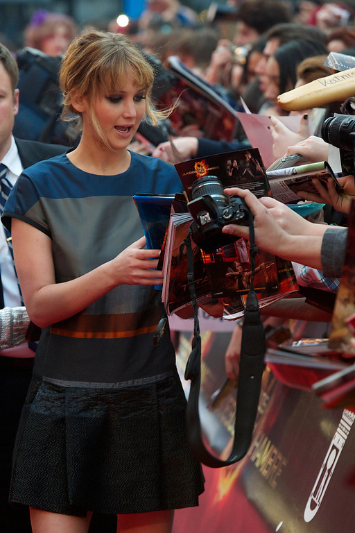 """. Actress  Jennifer Lawrence of \""""The Hunger Games\"""" (Los Juegos del Hambre) attends an event with fans at Capitol cinema on March 26, 2012 in Madrid, Spain.  (Photo by Carlos Alvarez/Getty Images)"""
