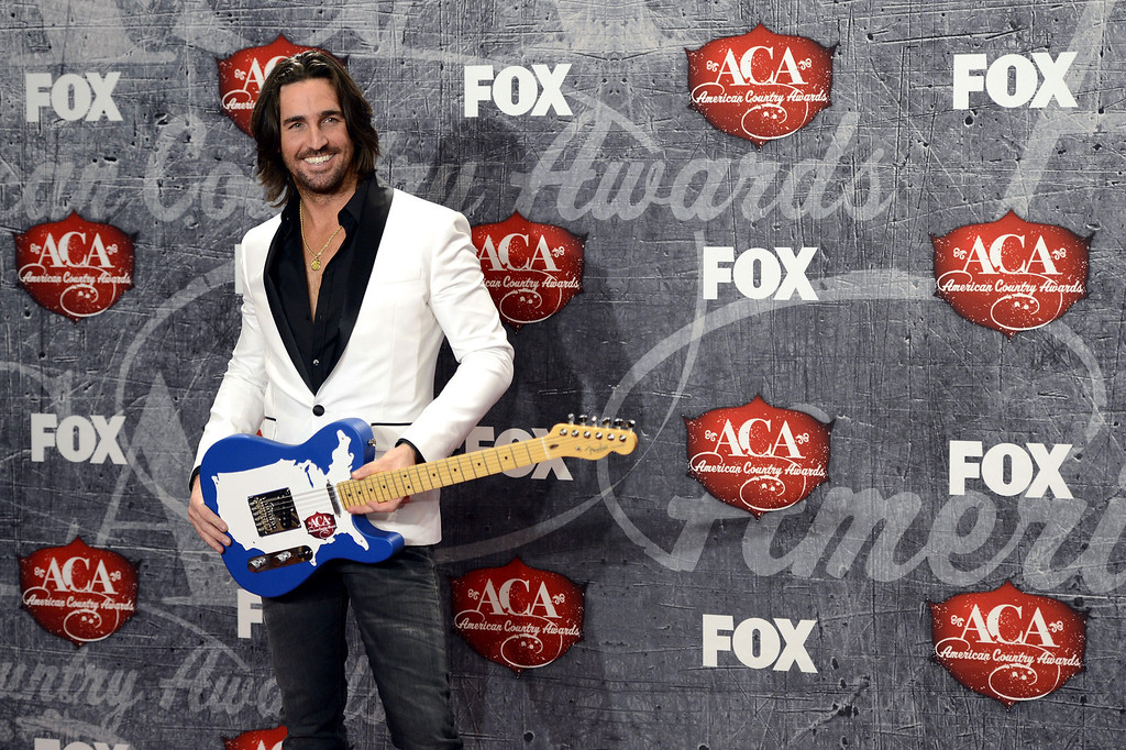 Description of . Recording artist Jake Owen poses in the press room with his award for Breakthrough Artist of the Year backstage at the American Country Awards on Monday, Dec. 10, 2012, in Las Vegas. (Photo by Jeff Bottari/Invision/AP)