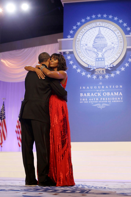 Description of . President Barack Obama and first lady Michelle Obama, wearing a ruby colored chiffon and velvet Jason Wu gown, dance as singer Jennifer Hudson, right, sings Al Green's