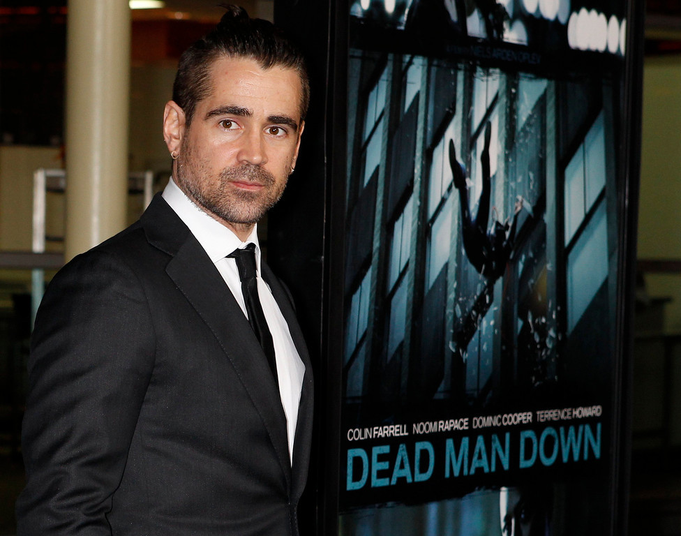 Description of . Irish actor Colin Farrell poses at the premiere of his new film
