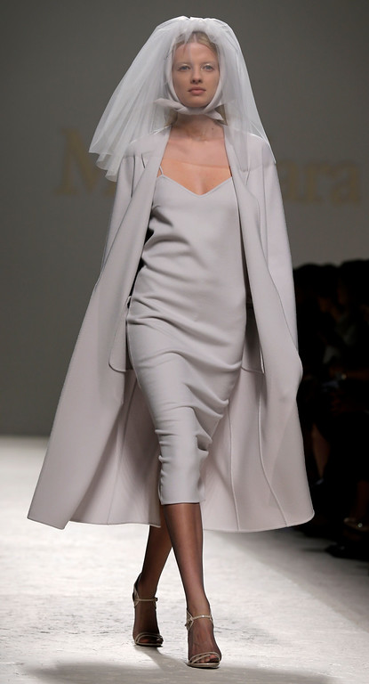 Description of . A model wears a creation for Max Mara women's Spring-Summer 2014 collection, part of the Milan Fashion Week, unveiled in Milan, Italy, Thursday, Sept. 19, 2013. (AP Photo/Luca Bruno)