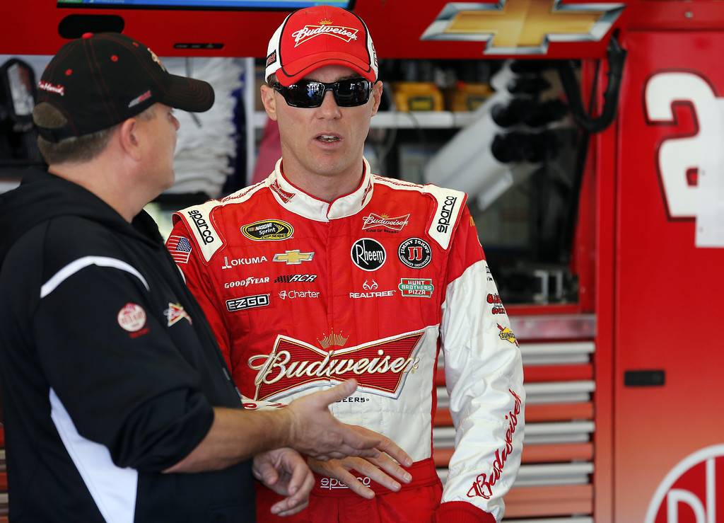 . DAYTONA BEACH, FL - FEBRUARY 20: Kevin Harvick, driver of the #29 Budweiser Chevrolet, speaks with a crew member before practice for the NASCAR Sprint Cup Series Daytona 500 at Daytona International Speedway on February 20, 2013 in Daytona Beach, Florida.  (Photo by Sam Greenwood/Getty Images)