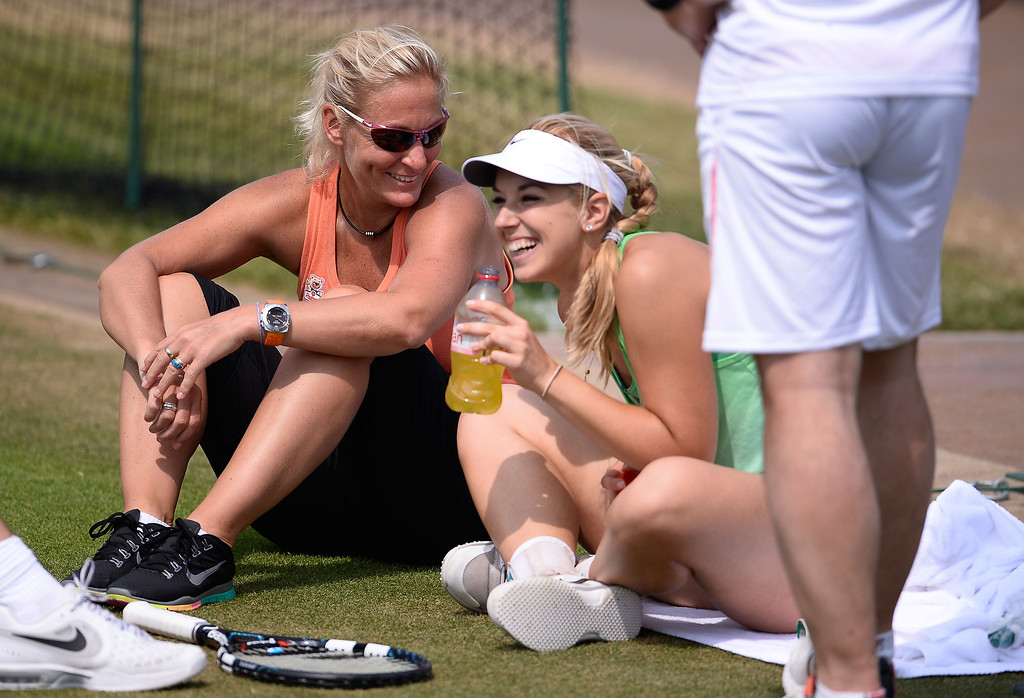 Description of . LONDON, ENGLAND - JULY 05:  Sabine Lisicki of Germany laughs as she talks with Barbara Rittner, captain of the German Fed Cup team during a practice session on day eleven of the Wimbledon Lawn Tennis Championships at the All England Lawn Tennis and Croquet Club on July 5, 2013 in London, England.  (Photo by Dennis Grombkowski/Getty Images)