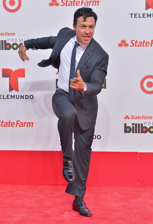 Description of . MIAMI, FL - APRIL 25:  Beto Perez arrives at Billboard Latin Music Awards 2013 at Bank United Center on April 25, 2013 in Miami, Florida.  (Photo by Gustavo Caballero/Getty Images)