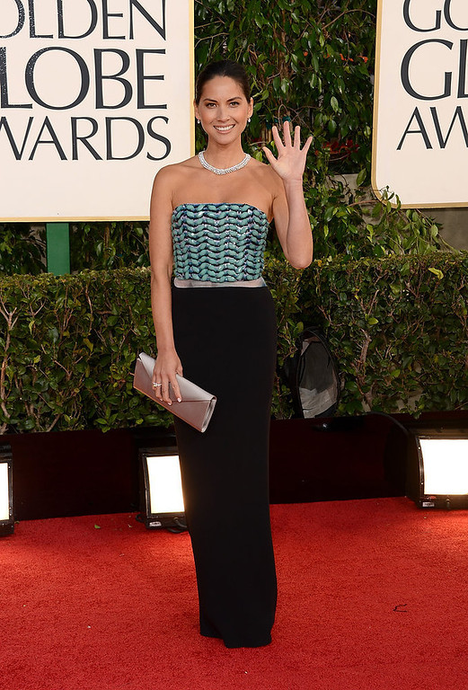 Description of . Actress Olivia Munn arrives at the 70th Annual Golden Globe Awards held at The Beverly Hilton Hotel on January 13, 2013 in Beverly Hills, California.  (Photo by Jason Merritt/Getty Images)