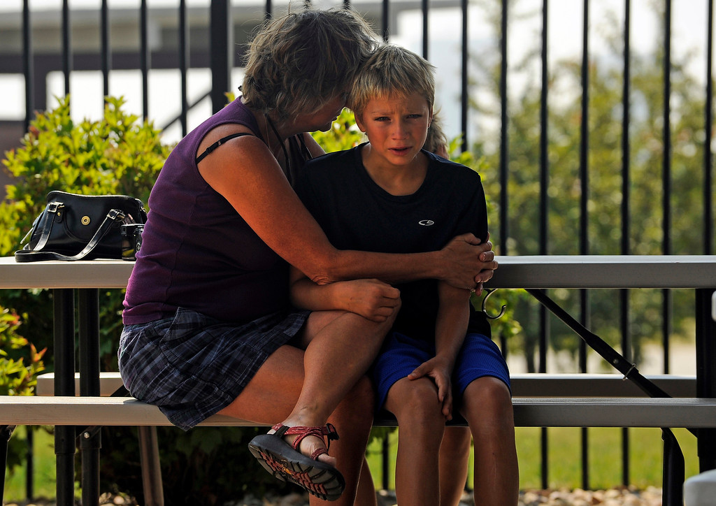 Description of . A family sits outside The Ranch in Loveland, Tuesday, June 12, 2012, after evacuees of the High Park fire had a community meeting to learn more about the fast moving fire. RJ Sangosti, The Denver Post