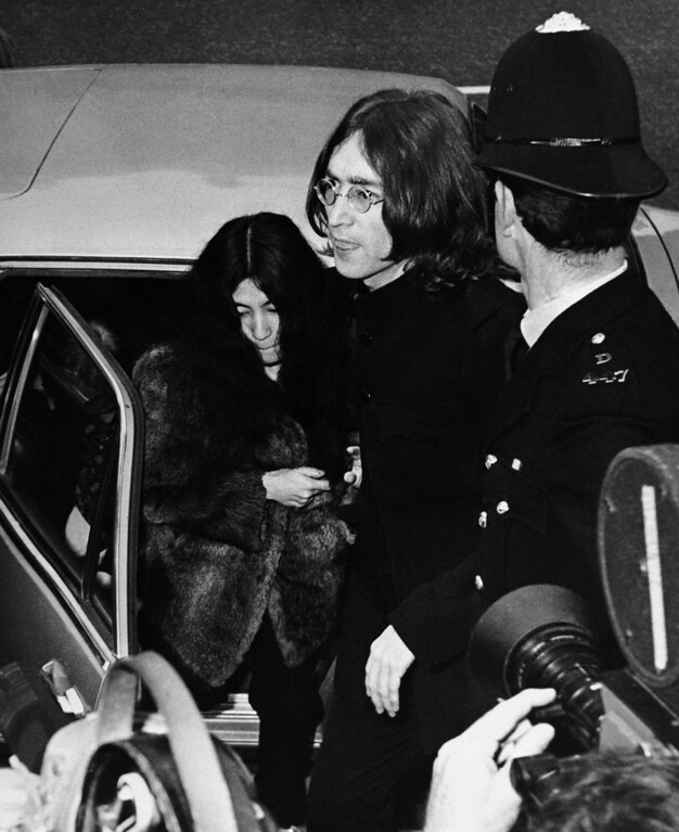 Description of . John Lennon, one of the Beatles, and his Japanese girl friend, Yoko Ono, leave car to enter Marylebone court in London on Oct. 19, 1968.   They appeared on charges of possessing cannabis, the British name for hashish.   The trial was set for late November after the police asked for time to have the seized drugs analyzed. (AP Photo)