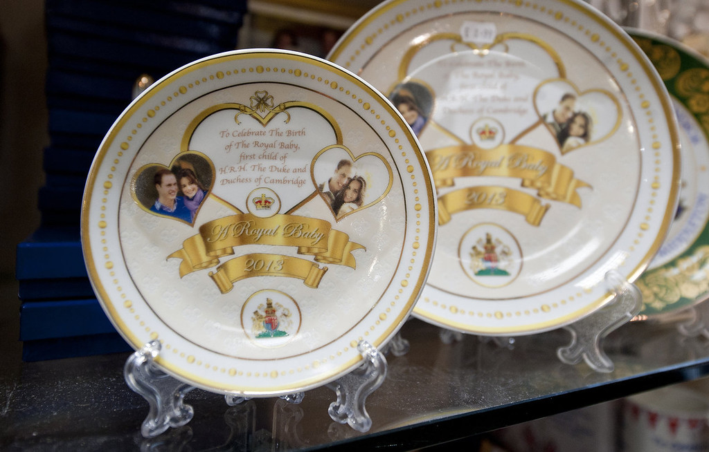 Description of . A display of plates, part of an assortment of souvenir gifts celebrating the upcoming birth of the royal baby of Prince William, Duke of Cambridge and Catherine, the Duchess of the Cambridge on sale in a Souvenir outlet in central London on June 26, 2013. The baby is expected to arrive in mid-July, with the mother likely to opt for a natural delivery. The baby, which will be third in line to the throne, will be born in the same London hospital wing where William himself was born to Prince Charles and Princess Diana.  WILL OLIVER/AFP/Getty Images