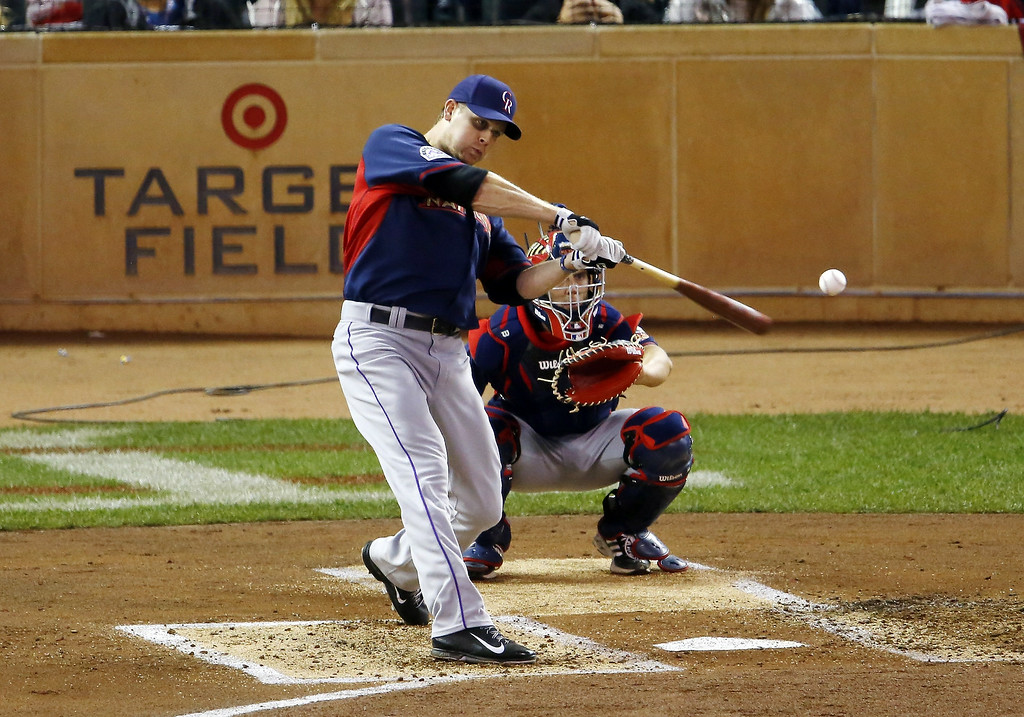 Description of . National League's Justin Morneau, of the Colorado Rockies, hits during the MLB All-Star baseball Home Run Derby, Monday, July 14, 2014, in Minneapolis. (AP Photo/Paul Sancya)