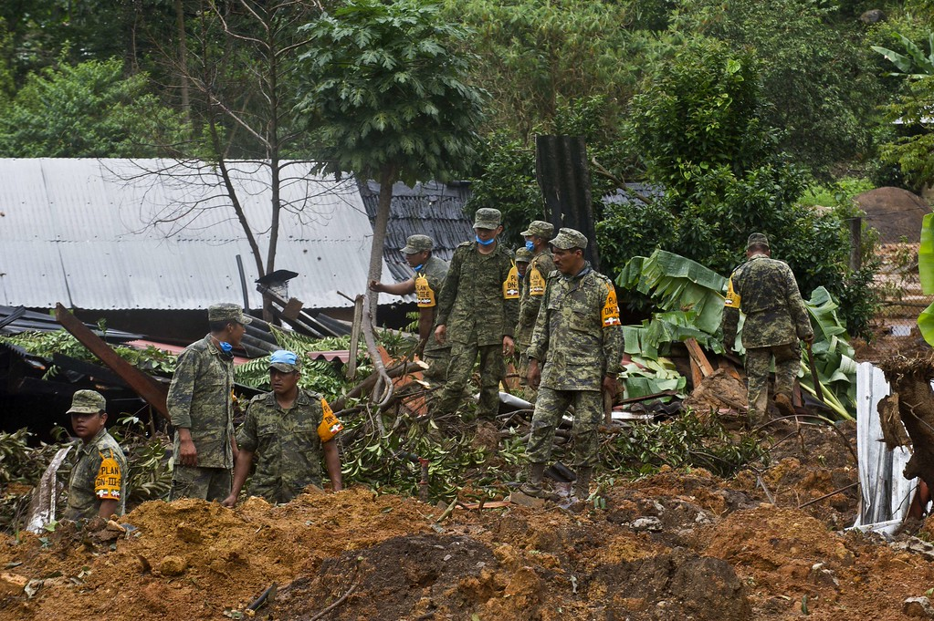 Description of . Mexican soldiers work on the site of a landslide in La Pintada, state of Guerrero, Mexico, on September 19, 2013 as heavy rains hit the country. AFP PHOTO/RONALDO  Schemidt/AFP/Getty Images