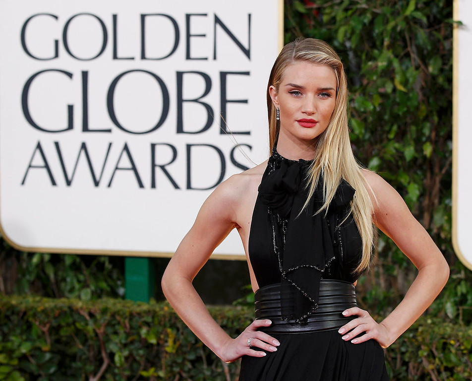 Description of . Model Rosie Huntington-Whiteley arrives at the 70th annual Golden Globe Awards in Beverly Hills, California, January 13, 2013.  REUTERS/Mario Anzuoni