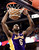 Los Angeles' Lakers Earl Clark gets slam dunk on the Denver Nuggets during their NBA basketball game in Denver, Colorado February 25, 2013.   REUTERS/Mark Leffingwell