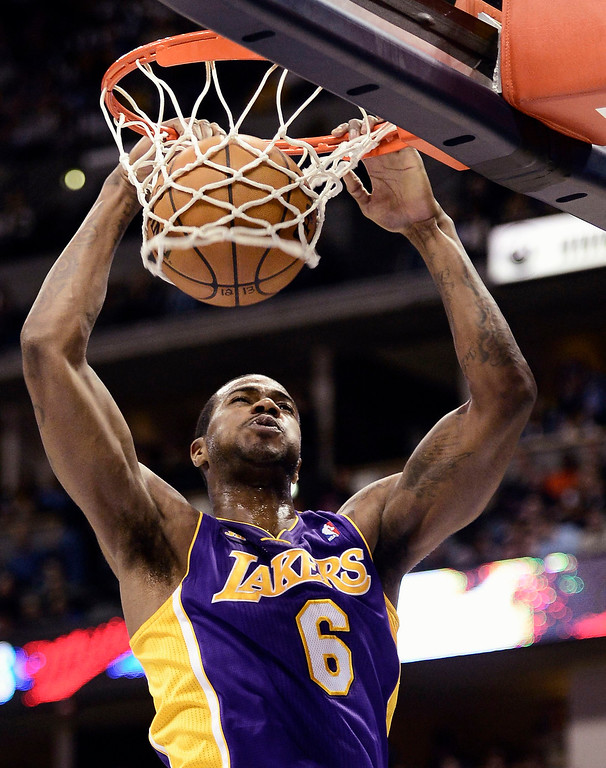 Description of . Los Angeles' Lakers Earl Clark gets slam dunk on the Denver Nuggets during their NBA basketball game in Denver, Colorado February 25, 2013.   REUTERS/Mark Leffingwell