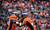 Denver Broncos free safety Rahim Moore (26) and Denver Broncos outside linebacker Wesley Woodyard (52) celebrate sacking Kansas City Chiefs quarterback Brady Quinn (9) during the second quarter. The Denver Broncos vs Kansas City Chiefs at Sports Authority Field Sunday December 30, 2012. Joe Amon, The Denver Post