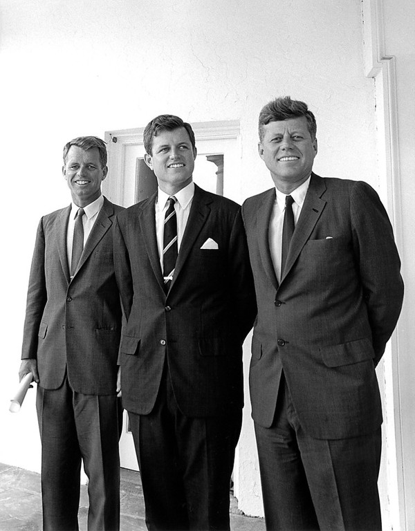 Description of . President Kennedy and his brothers, Attorney General Robert F. Kennedy, left, and Sen. Edward M. Kennedy stand outside the Oval Office on Aug.  28, 1963. Cecil Stoughton, John F. Kennedy Presidential Library and Museum