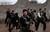 FILE - Syrian rebels attend a training session in Maaret Ikhwan, near Idlib, Syria, Monday, Dec. 17, 2012. (AP Photo/Muhammed Muheisen, File)