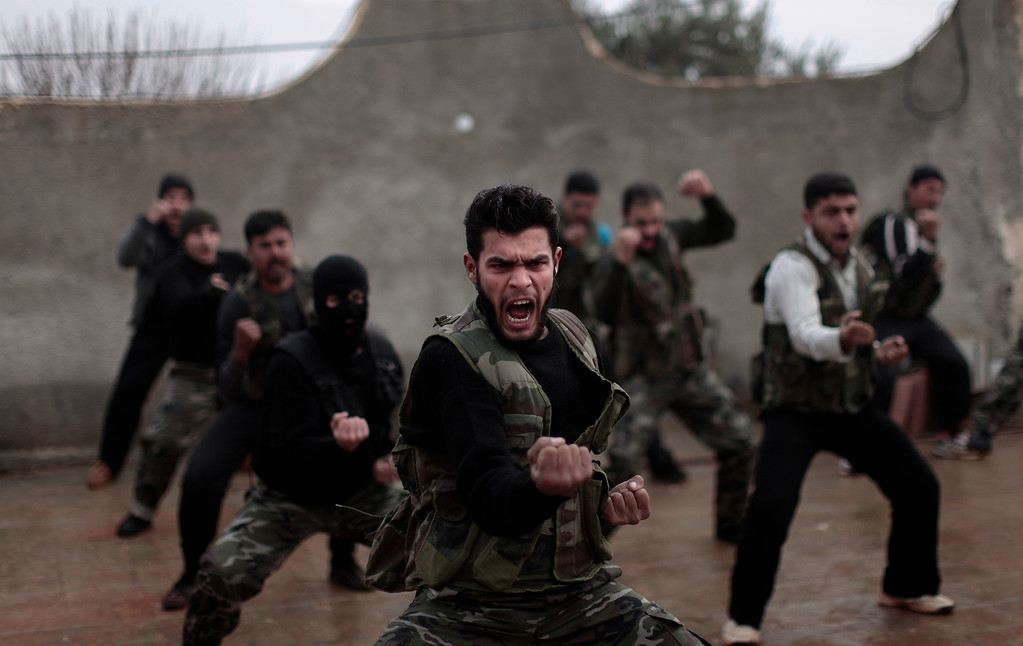 Description of . FILE - Syrian rebels attend a training session in Maaret Ikhwan, near Idlib, Syria, Monday, Dec. 17, 2012. (AP Photo/Muhammed Muheisen, File)