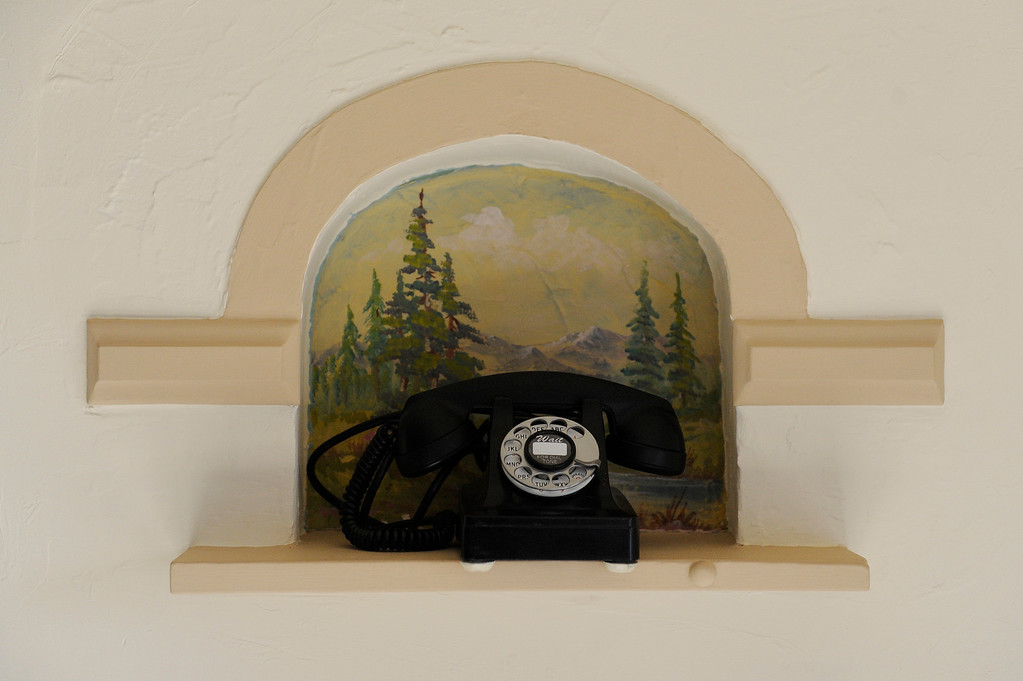 Description of . DENVER, CO - NOVEMBER 13: A telephone nook beside the front door of the Spicer residence on November 13, 2013, in Denver, Colorado. The painting behind the phone is an original dating back to 1936. (Photo by Anya Semenoff/YourHub)