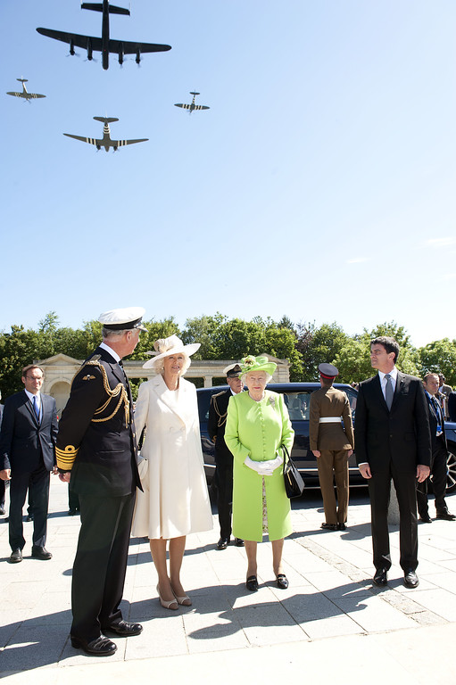 Description of . Prince Charles, Prince of Wales, Camilla, Duchess of Cornwall and Queen Elizabeth ll attend a service at Bayeux Cemetary during D-Day 70 Commemorations on June 6, 2014 in Bayeux, France.  (Photo by Murray Sanders - Pool/Getty Images)