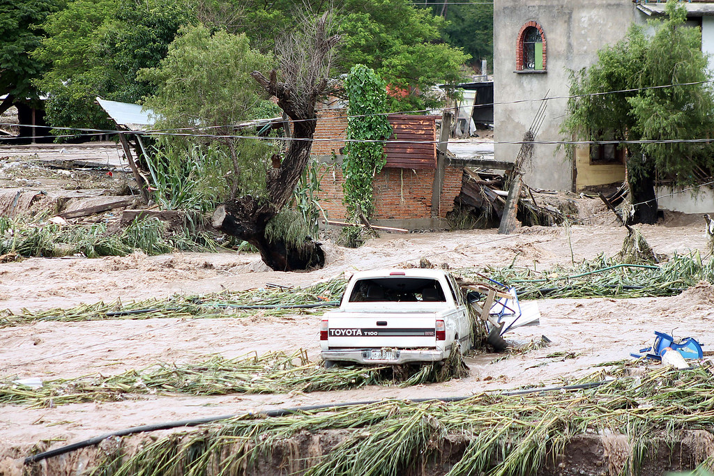 Description of . View of a flooded area in Chilpancingo, state of Guerrero, Mexico, on September 17, 2013. Mexican authorities scrambled Tuesday to launch an air lift to evacuate tens of thousands of tourists stranded amid floods in the resort of Acapulco following a pair of deadly storms. The official death toll rose to 47 after the tropical storms, Ingrid and Manuel, swarmed large swaths of the country during a three-day holiday weekend, sparking landslides and causing rivers to overflow in several states. EDUARDO GUERRERO/AFP/Getty Images