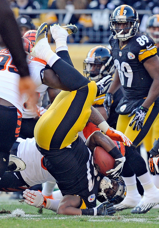 Description of . Pittsburgh Steelers running back Jonathan Dwyer (27) flips over as he is tackled on a run in the second quarter of an NFL football game against the Cincinnati Bengals on Sunday, Dec. 23, 2012, in Pittsburgh. (AP Photo/Don Wright)