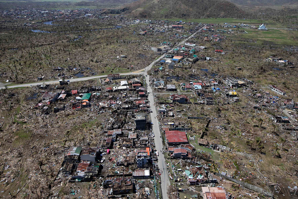 Description of . An aerial shot taken from a Philippine Air Force helicopter shows the devastation of last week's typhoon which lashed a vast area in Leyte province, central Philippines Friday, Nov.15, 2013.  (AP Photo/Bullit Marquez)