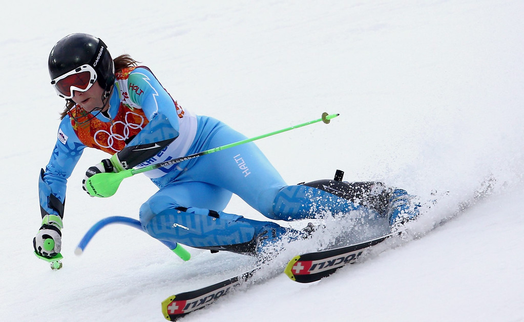 Description of . Tina Maze of Slovenia in action during the first run of the Women's Slalom race at the Rosa Khutor Alpine Center during the Sochi 2014 Olympic Games, Krasnaya Polyana, Russia, 21 February 2014.  EPA/KARL-JOSEF HILDENBRAND