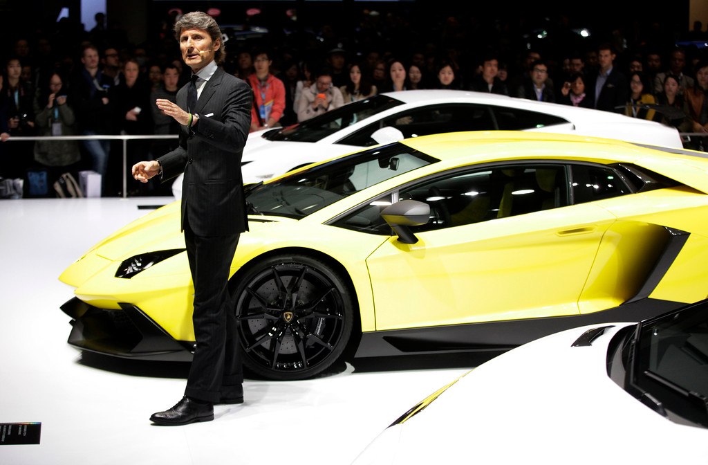 Description of . Lamborghini CEO Stephan Winkelmann unveils new Lamborghini Aventador 50th Anniversary model at the Shanghai International Automobile Industry Exhibition (AUTO Shanghai) media day in Shanghai, China Saturday, April 20, 2013. (AP Photo/Eugene Hoshiko)