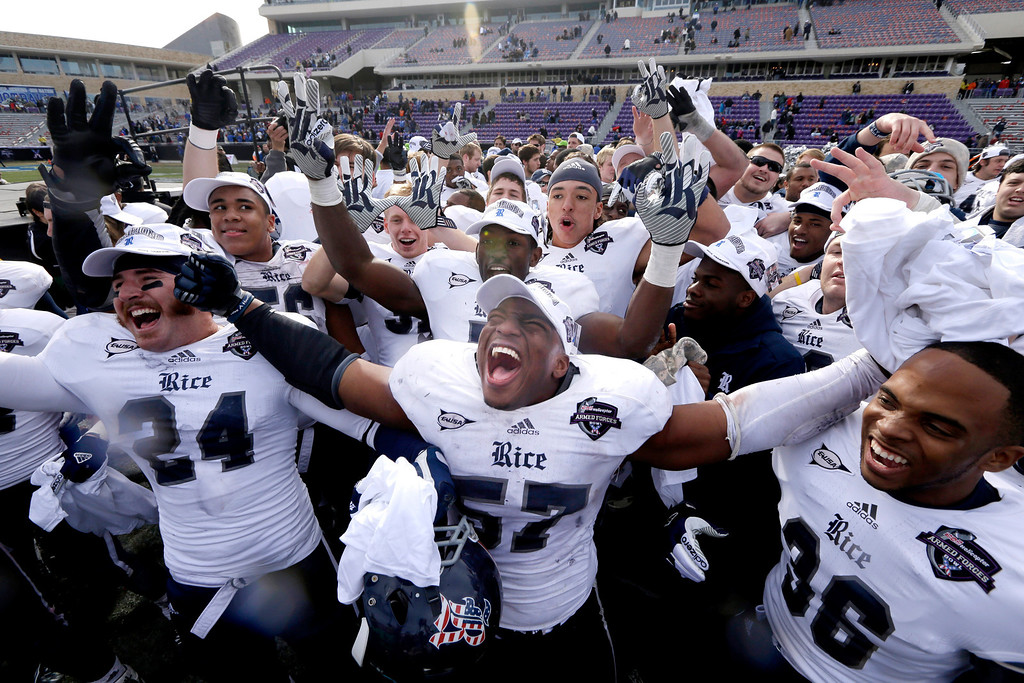 Description of . Rice linebacker Cameron Nwosu (57) celebrates with safety Paul Porras (24) and defensive end Dylan Klare (96) after the Armed Forces Bowl NCAA college football game against Air Force Saturday, Dec. 29, 2012, in Fort Worth, Texas. Rice won 33-14. (AP Photo/LM Otero)