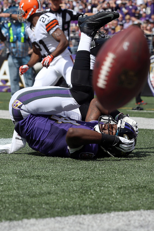 Description of . Wide receiver Marlon Brown #14 of the Baltimore Ravens bobbles a catch in the end zone during the first quarter against the Cleveland Browns at M&T Bank Stadium on September 15, 2013 in Baltimore, Maryland.  (Photo by Rob Carr/Getty Images)