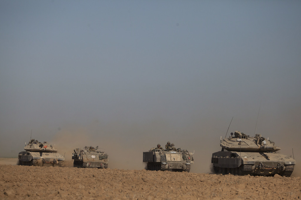 Description of . Israeli tanks and Army Armoured Personnel Carrier (APC) seen moving along the border with Gaza on July 17, 2014 on Israel's border with the Gaza Strip. As the Israeli operation 'Protective Edge' enters it's tenth day, the body count in Gaza has reach over 200 people. One Israeli has been killed in a Mortar attack.  (Photo by Lior Mizrahi/Getty Images)