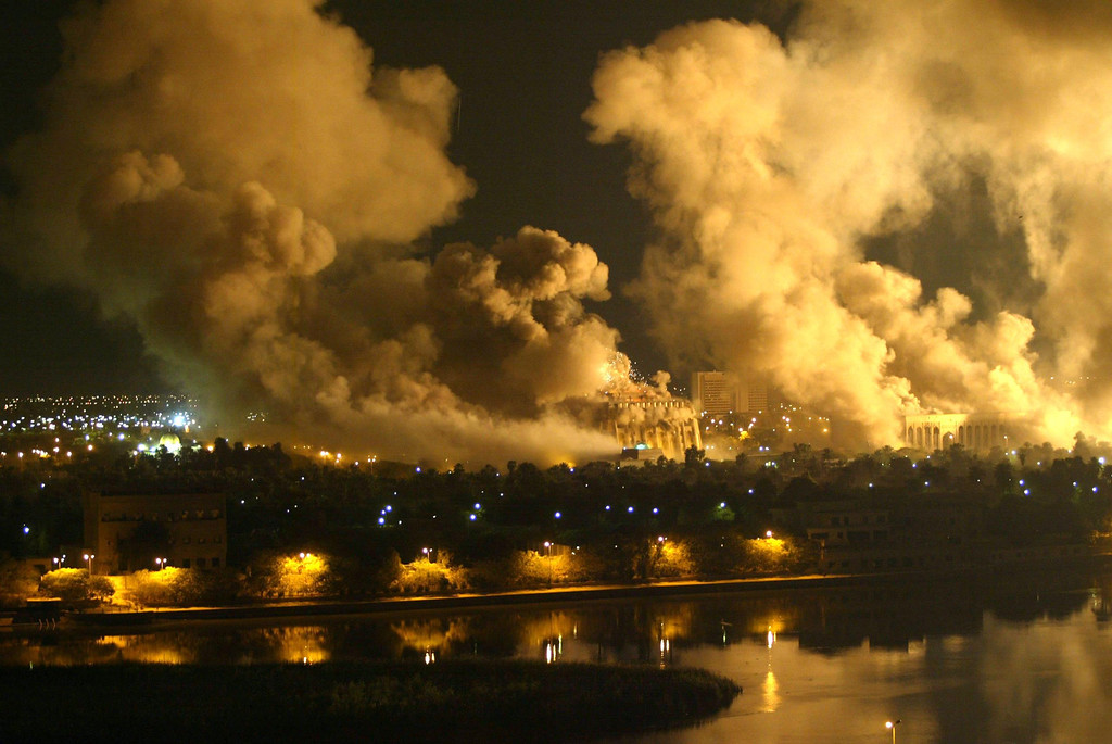 Description of . Smoke covers the presidential palace compound in Baghdad on March 21, 2003 during a massive US-led air raid on the Iraqi capital. Smoke billowed from a number of targeted sites, including one of President Saddam Hussein\'s palaces, an AFP correspondent said. AFP Photo/Ramzi Haidar