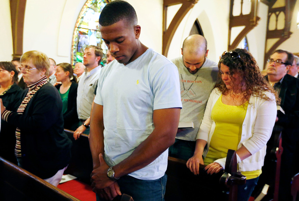Description of . A worshiper bows his head during a memorial service for Boston Marathon bombing victim Krystle Campbell at Grace Episcopal Church in Medford, Mass., Wednesday, April 17, 2013. (AP Photo/Michael Dwyer)