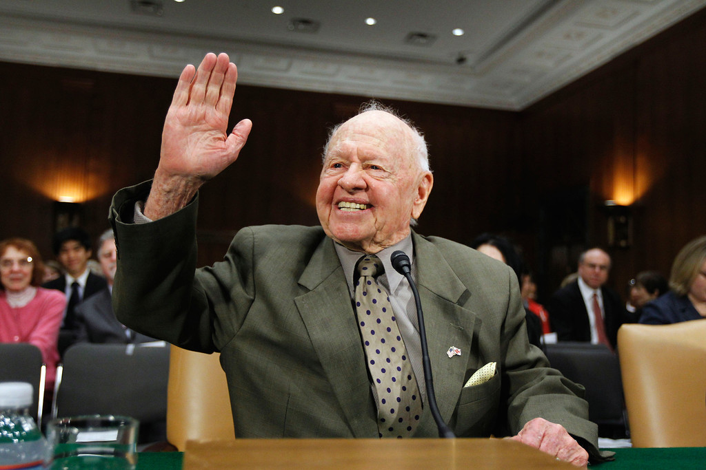 Description of . In this Wednesday, March 2, 2011, file photo, entertainer Mickey Rooney waves on Capitol Hill in Washington, prior to testifying about elder abuse, before the Senate Aging Committee.  (AP Photo/Alex Brandon, File)