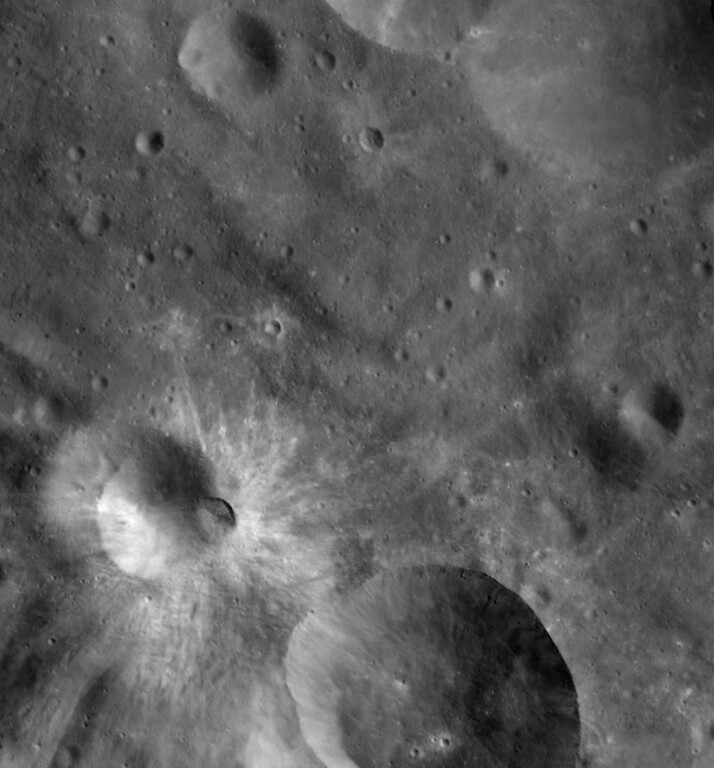 Description of . This image released Monday, Dec. 5, 2011, by NASA is a mosaic of three images taken by the Dawn spacecraft's camera showing an impact crater on the surface of the massive asteroid Vesta. Since entering orbit around Vesta in July, Dawn has been beaming back images of the asteroid surface. (AP Photo/NASA)