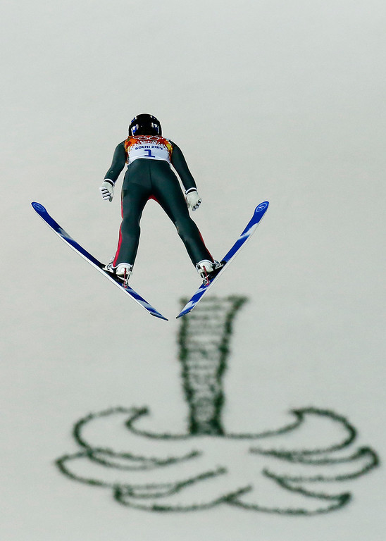 Description of . United States\' Sarah Hendrickson makes the first attempt during the women\'s normal hill ski jumping final at the 2014 Winter Olympics, Tuesday, Feb. 11, 2014, in Krasnaya Polyana, Russia. (AP Photo/Dmitry Lovetsky)
