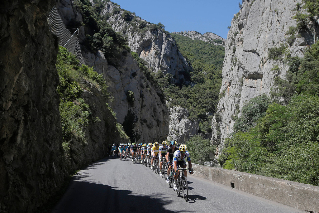 . The pack climbs towards Pailheres pass during the eight stage of the Tour de France cycling race over 195 kilometers (122 miles) with start in Castres and finish in Ax 3 Domaines, Pyrenees region, France, Saturday July 6 2013. (AP Photo/Laurent Cipriani)