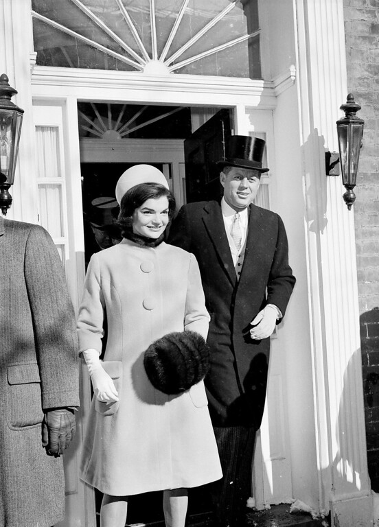 Description of . U.S. President-elect John F. Kennedy, wearing his high hat, and his wife, Jacqueline Kennedy, are shown as they leave their Georgetown resident for the inauguration day ceremonies in Washington, D.C., Jan. 20, 1961. Kennedy will be sworn in as the 35th President of the United States. (AP Photo)