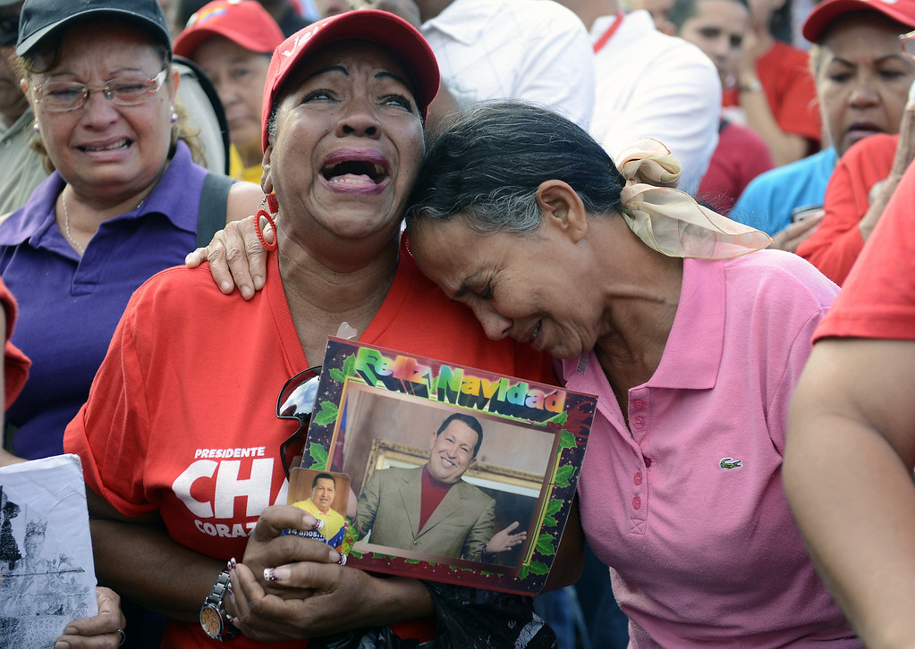 Description of . Supporters of the late Venezuelan President Hugo Chavez cry in front of the Military Hospital --where he had been hospitalized-- a day after his death in March 6, 2013, in Caracas. Venezuela was plunged into uncertainty after the death of President Chavez, who dominated the oil-rich country for 14 years and came to embody a resurgent Latin American left.   LEO RAMIREZ/AFP/Getty Images