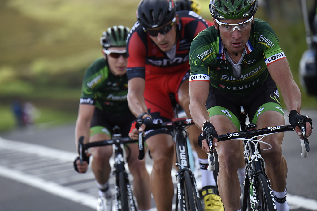 Description of . France's Thomas Voeckler (R), Germany's Marcus Burghardt (C), and France's Cyril Gautier ride in a breakaway during the 201 km second stage of the 101th edition of the Tour de France cycling race on July 6, 2014 between York and Sheffield, northern England.  AFP PHOTO / ERIC FEFERBERGERIC FEFERBERG/AFP/Getty Images