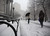 People walk through driving snow near courthouses in lower Manhattan during a storm on Friday, March. 8 2013, in New York. (AP Photo/Peter Morgan)