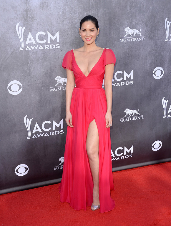 Description of . Actress Olivia Munn attends the 49th Annual Academy Of Country Music Awards at the MGM Grand Garden Arena on April 6, 2014 in Las Vegas, Nevada.  (Photo by Jason Merritt/Getty Images)