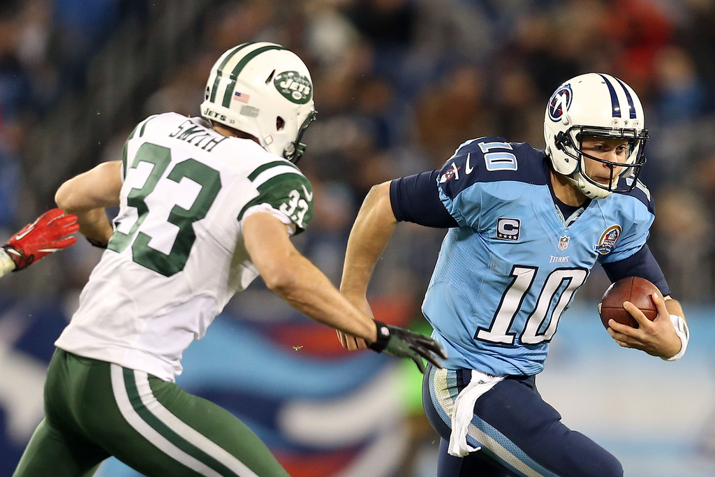 Description of . NASHVILLE, TN - DECEMBER 17:  Quarterback Jake Locker #10 of the Tennessee Titans runs with the ball against free safety Eric Smith #33 of the New York Jets at LP Field on December 17, 2012 in Nashville, Tennessee.  (Photo by Andy Lyons/Getty Images)